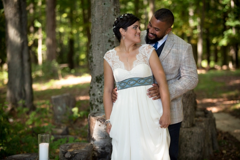 Photo of a couple in a wooded area.